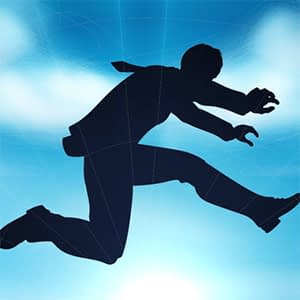 Silhouette of businessman jumping a gap