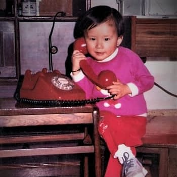 Photo of a young Amanda Chen talking on the phone